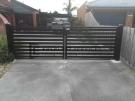 DG20 – Black Horizontal Slats Driveway Gate