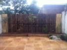 L13 – Bamboo Fence Screening with Sandstone Paving