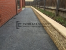 EA8 – Dark Exposed Aggregate Side of House