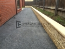 EA1 – Dark Exposed Aggregate Side of House
