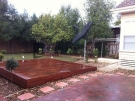 L35 – Raised Timber Decking with Pebblem Landscaping