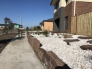 L85 – Front Mud Rock Retaining Wall + White Ice Pebble