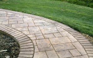 Stamped stencilled concrete versus paving