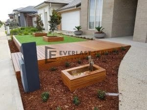 Front Decking with Garden Box and Cladded Retaining Wall