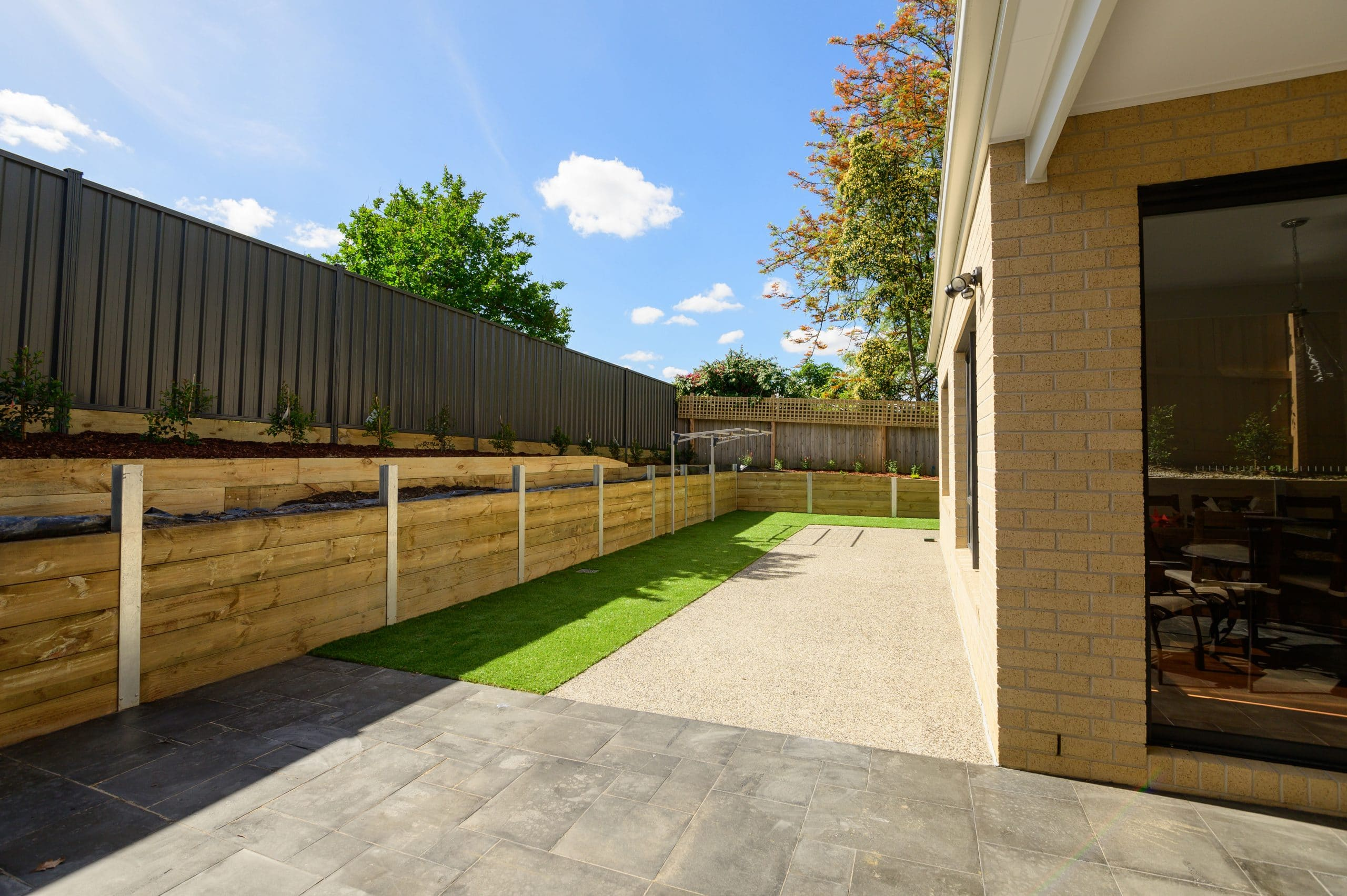 L258 - Doncaster East - back yard, retaining wall and grass path