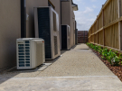 EA100 – Point Cook – Side of house with aircon units