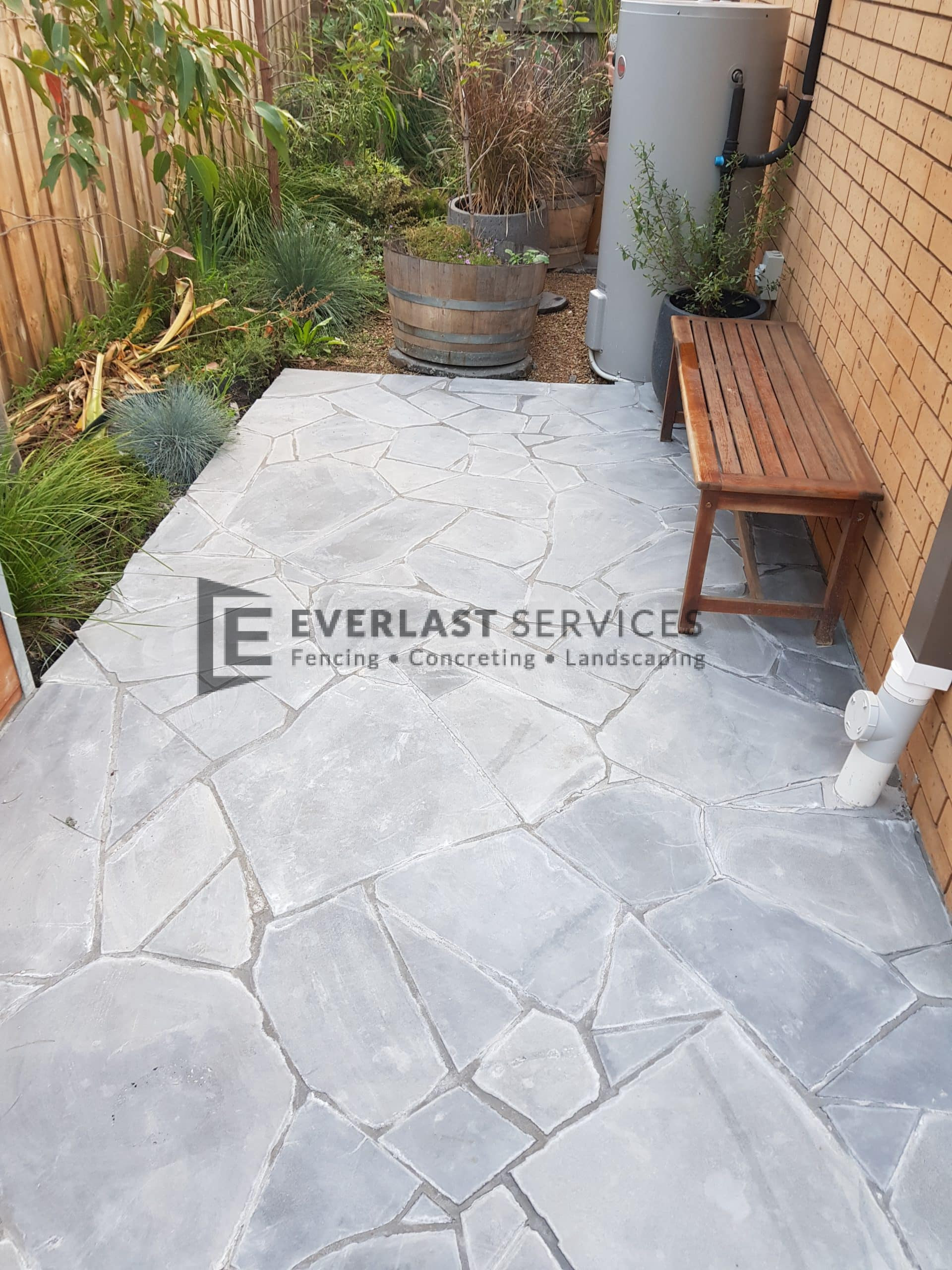 L279 - Everlast Landscaping stenciled concrete with seat