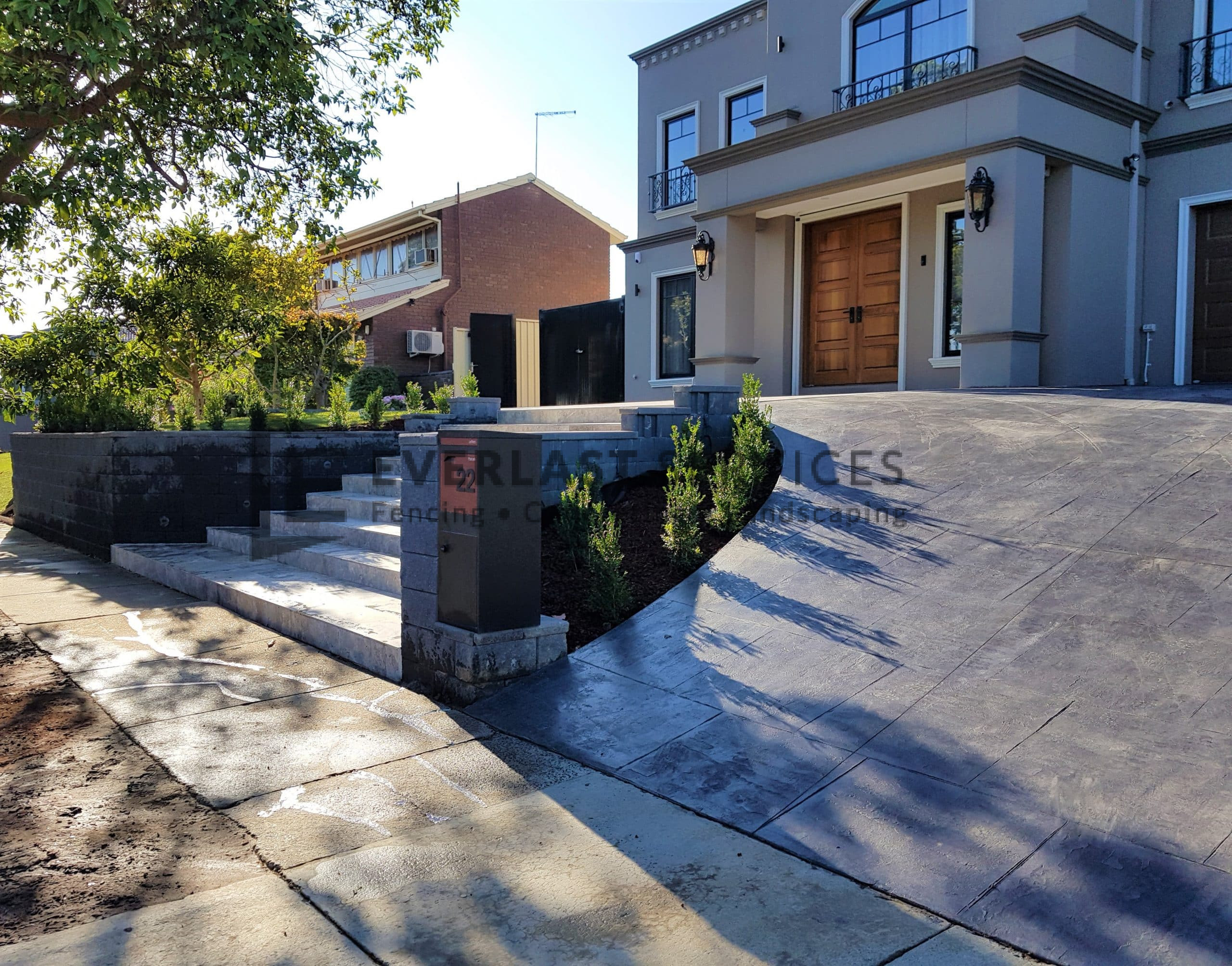 L282 - Landscaping front yard with stamped concrete path