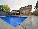 L285 – Yarraville – Backyard Landscaping with Glass Pool Fence (Corner Perspective)