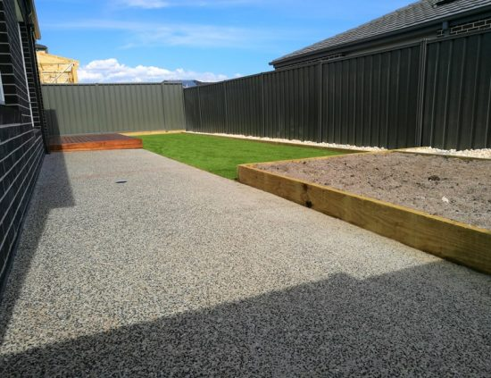 Back yard - Exposed Aggregate with Synthetic Grass and Decking